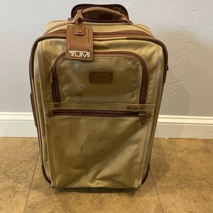 Tumi tan color carryon suitcase in good condition.